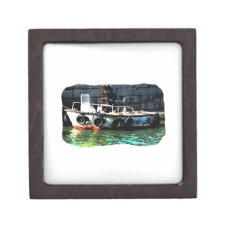 Small boat ladder tires in ocean by tug gift box