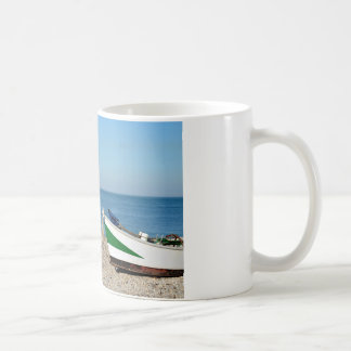 Small boat on pebble beach of Etretat in France Coffee Mug