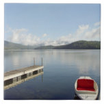 Small boat tied up on dock at Lake Placid Ceramic Tile