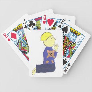 Small boy praying bicycle playing cards