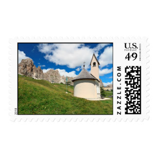 small chapel in Dolomites Stamp