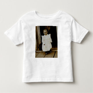small child in doorway toddler t-shirt