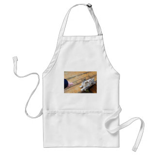 Small cute kitten playing with a twig in the stree adult apron
