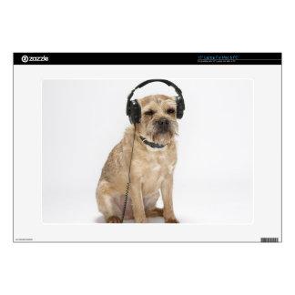 Small dog wearing headphones laptop decals