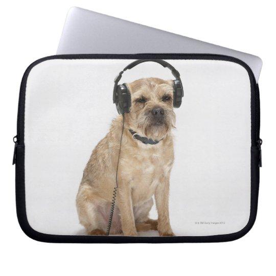 Small dog wearing headphones laptop sleeve