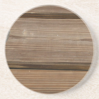 Small glass on wooden brown fishing dock planks beverage coasters