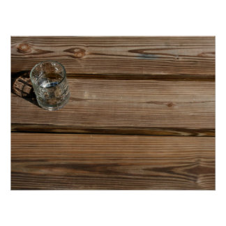 Small glass on wooden brown fishing dock planks posters