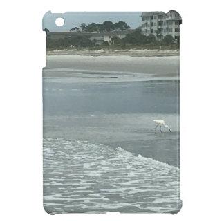 Small heron on the beach iPad mini covers