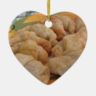 Small homemade salty croissants stuffed ceramic ornament