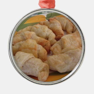 Small homemade salty croissants stuffed metal ornament