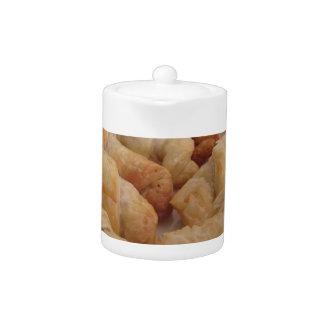 Small homemade salty croissants stuffed teapot