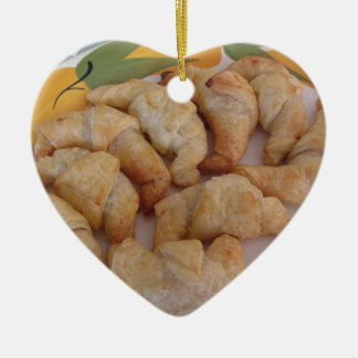 Small homemade salty croissants with sausage ceramic ornament
