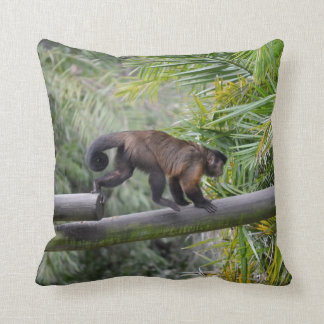 small monkey running across railing throw pillow
