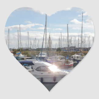 Small Motorboat Catching The Sun Heart Sticker