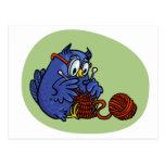 Small owl knits a scarf postcard