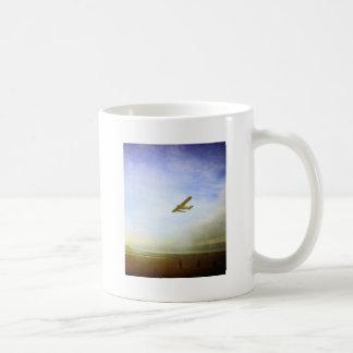 Small plane with blue sky mugs
