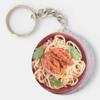 Small portion of cooked spaghetti with tomato keychain