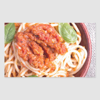 Small portion of cooked spaghetti with tomato rectangular sticker