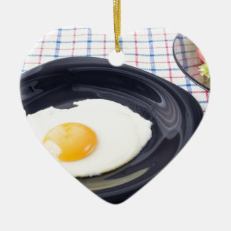 Small portion of the breakfast of fried egg ceramic ornament