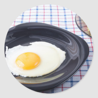Small portion of the breakfast of fried egg classic round sticker