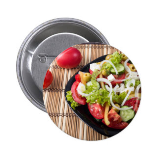 Small portion of vegetable salad of tomato button