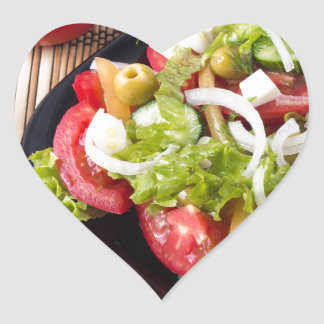Small portion of vegetable salad of tomato heart sticker