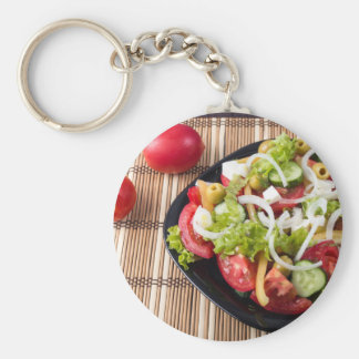 Small portion of vegetable salad of tomato keychain