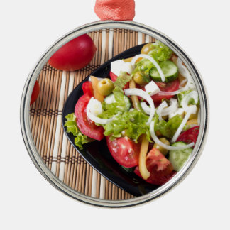 Small portion of vegetable salad of tomato metal ornament