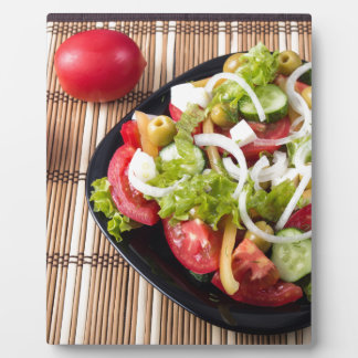 Small portion of vegetable salad of tomato plaque