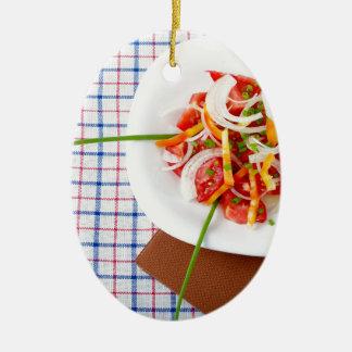 small portion of vegetarian salad ceramic ornament