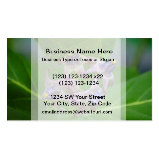 small purple flowers against green leaves business card