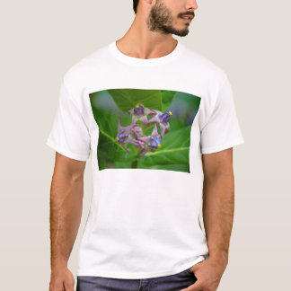 Small Purple Flowers Against Green Leaves T Shirt