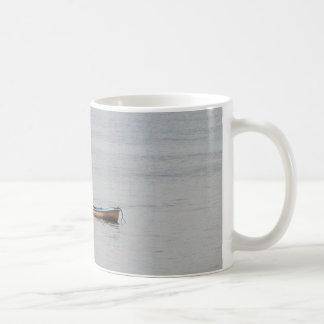 small rowing boat in calm sea coffee mug