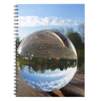 Small sea seen through a crystal ball notebook