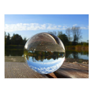 Small sea seen through a crystal ball postcard