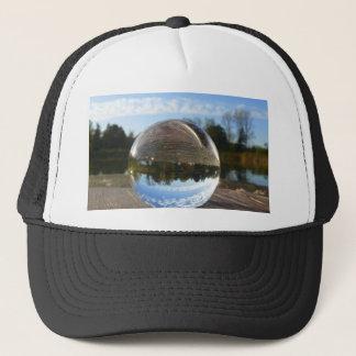 Small sea seen through a crystal ball trucker hat