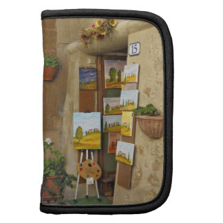 Small shope with artwork for sale on sidewalk folio planner