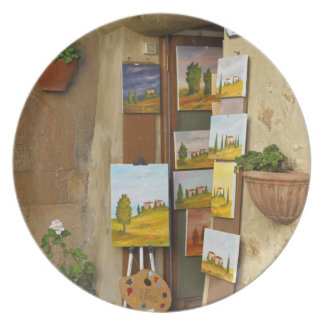 Small shope with artwork for sale on sidewalk party plates