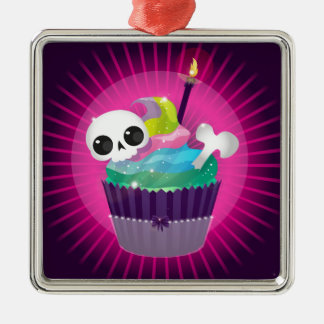 Small tasty cake with a skull for a gothic party metal ornament