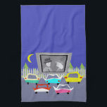 "Small Town Drive-In Movie Kitchen Towel<br><div class=""desc"">Pass the popcorn! This Small Town Drive-In Movie Kitchen Towel will transport you to a simpler time, when gas was cheap, rock and roll was young, and the movie stars of Hollywood&#39;s Golden Age shined brighter than the night sky. The design features the rear view of five, virtually indestructible, retro...</div>"