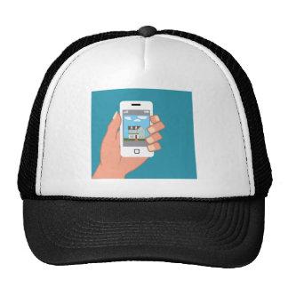 Smartphone a disposición con la imagen de la casa gorro