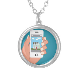 Smartphone in hand with house picture round pendant necklace