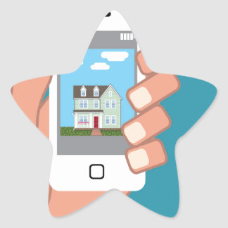 Smartphone in hand with house picture star sticker