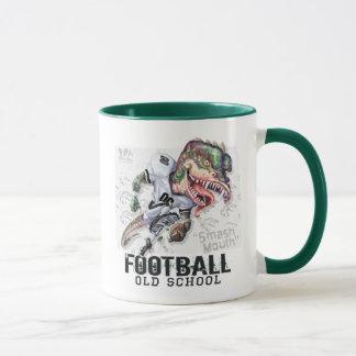 Smash Mouth Dinosaur Football By Mudge Studios Mug