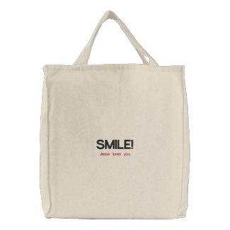 SMILE! Jesus loves you. Embroidered Bag