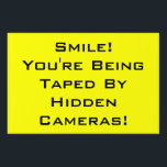 "Smile! You&#39;re Being Taped By Hidden Cameras Sign<br><div class=""desc"">Safety sign.  Post or mount as yard sign in easily visible location.</div>"