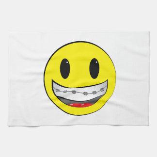 Smiley con los apoyos toallas de mano
