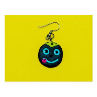 Smiley face earring postcard