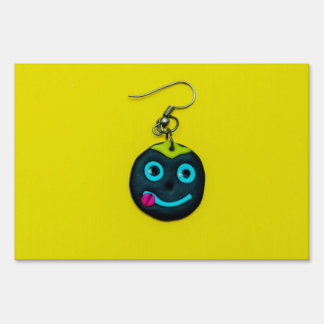 Smiley face earring lawn sign