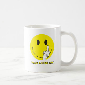 smiley face giving the finger coffee mug